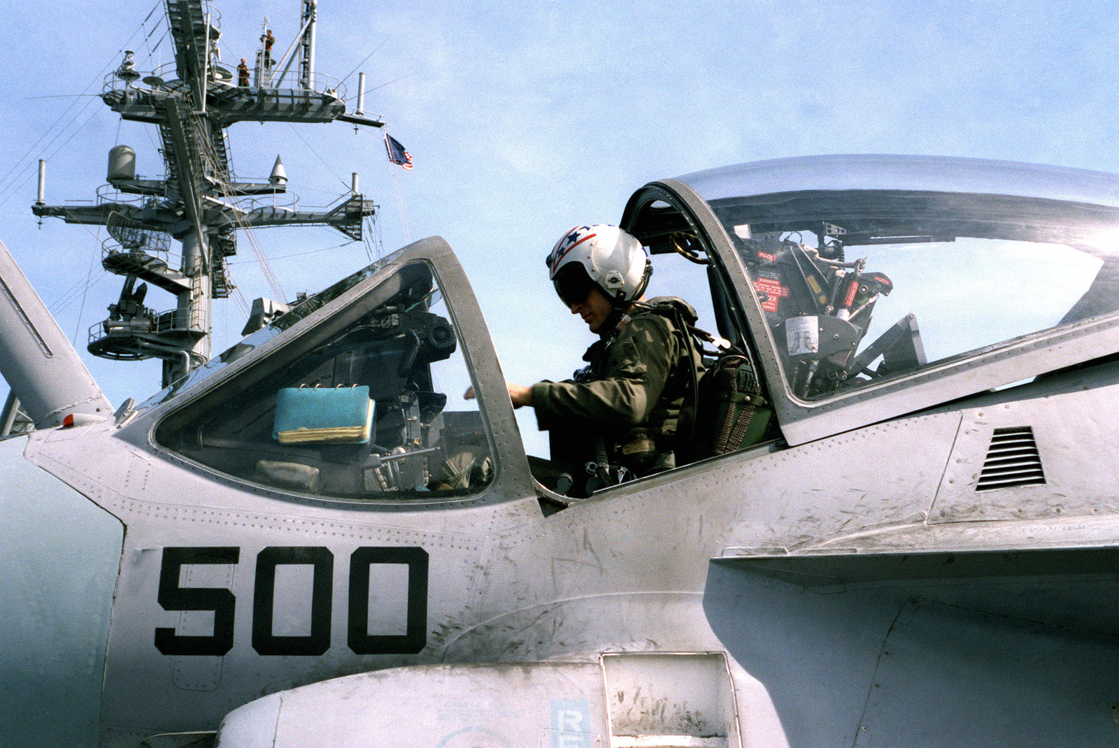 An Attack Squadron 34 (VA-34) pilot conducts a preflight check in the cockpit of his A-6E Intruder aircraft on the flight deck of the nuclear-powered aircraft carrier USS DWIGHT D. EISENHOWER (CVN 69)