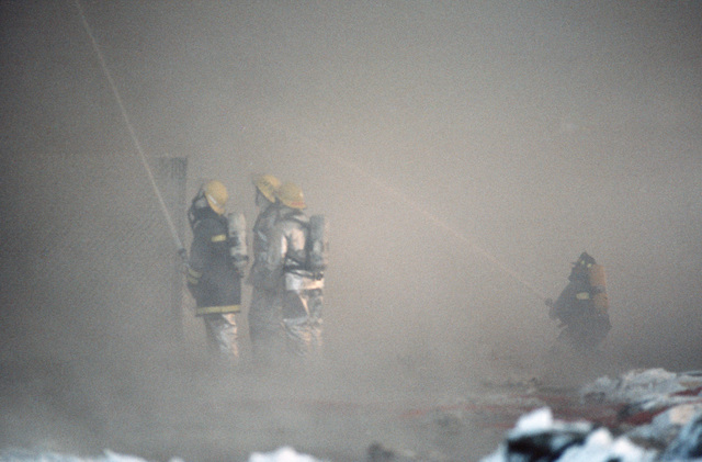 Firefighters engulfed in smoke battle a blaze caused by a propane leak at the Adak warehouse