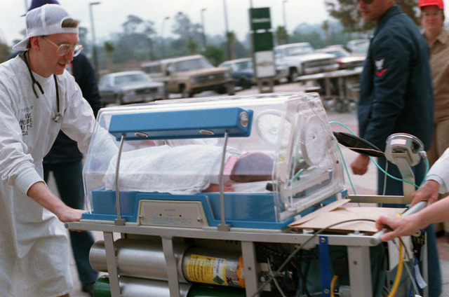STAFF members move an incubator from the old Navy hospital to the new Balboa Naval Hospital, located in Murphy Canyon