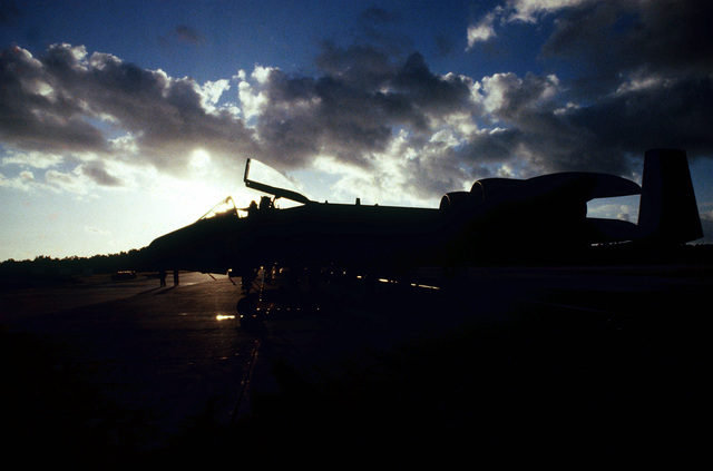 A 926th Tactical Fighter Group A-10 Thunderbolt II aircraft is silhouetted by the sun during exercise PATRIOT PEARL