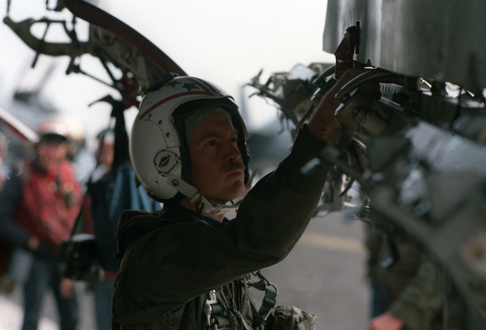 A pilot from Attack Squadron 34 (VA-34) conducts a final preflight check of his A-6E Intruder aircraft on the flight deck of the US Navy (USN) Nuclear-powered Aircraft Carrier USS DWIGHT D. EISENHOWER (CVN 69)