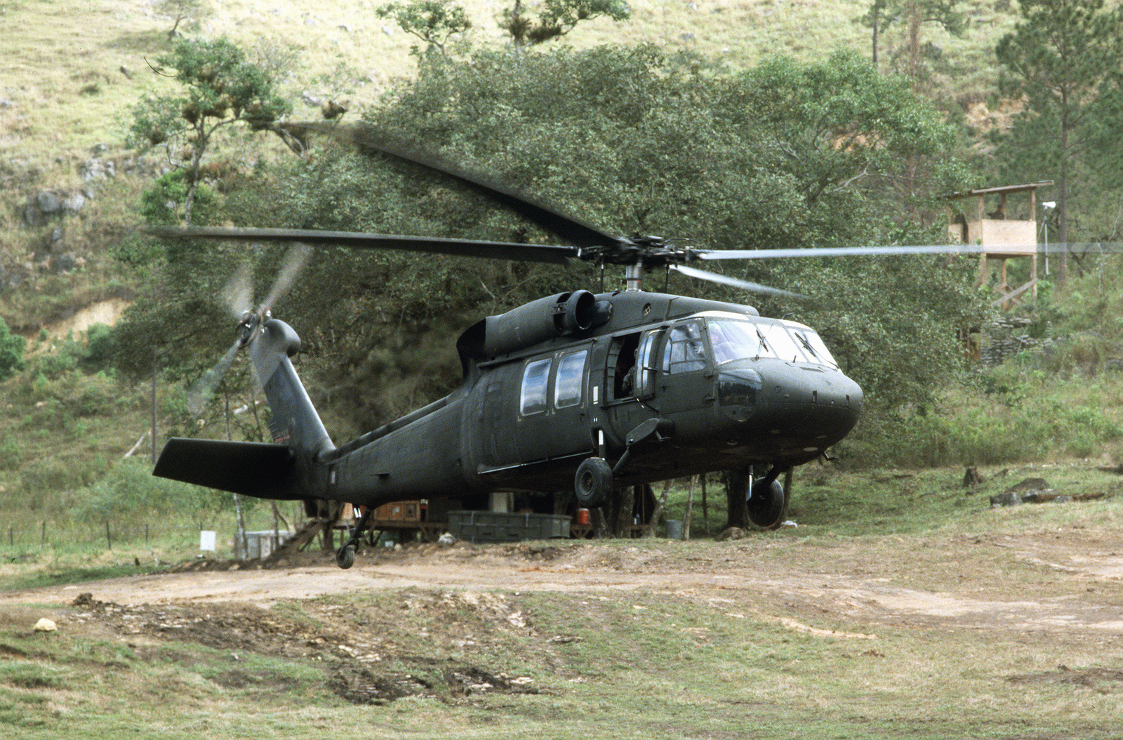 A UH-60 Black Hawk (Blackhawk) helicopter takes off during