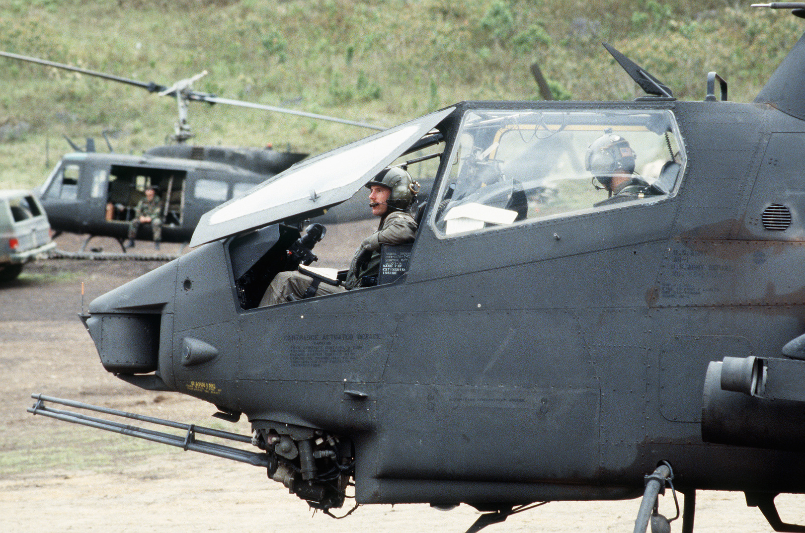 AH-1 Cobra helicopters in the field during Task Force III, a civic action project in which the West Virginia Army National Guard is constructing a road network and providing health and veterinary services to inhabitants of the Puenta Grande area