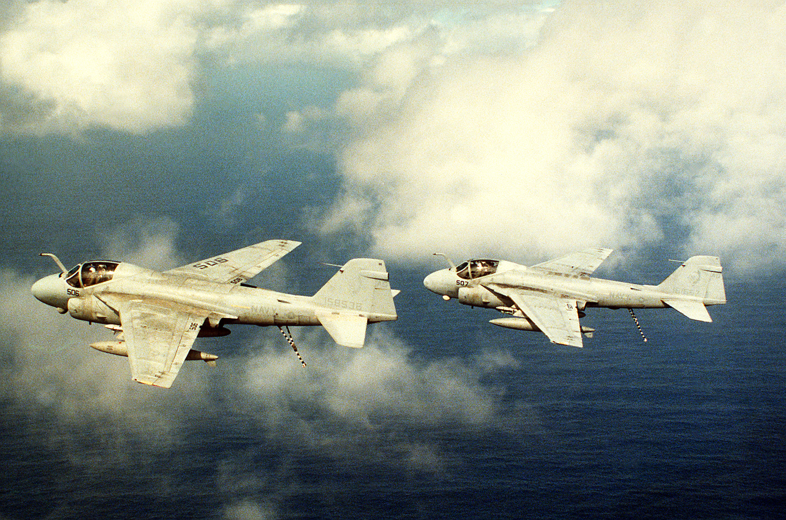 An air-to-air left side view of two A-6E Intruder aircraft flying in formation