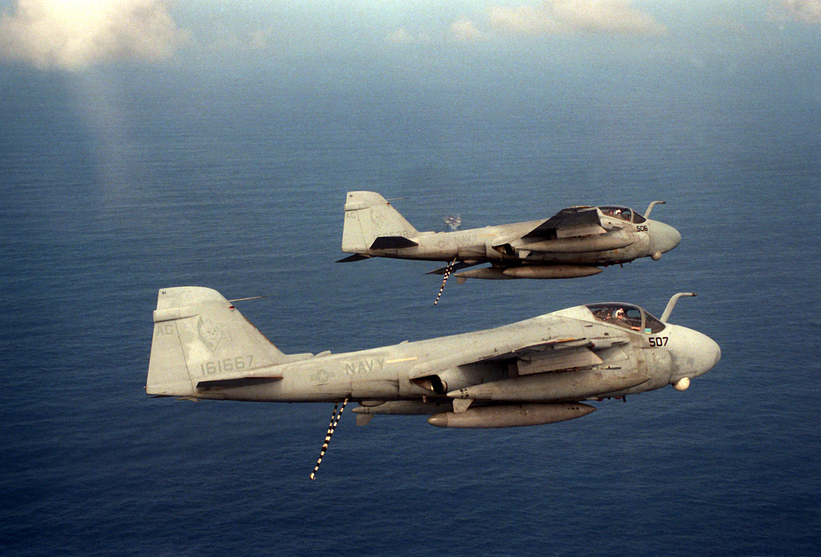 An air-to-air right side view of two A-6E Intruder aircraft flying in formation