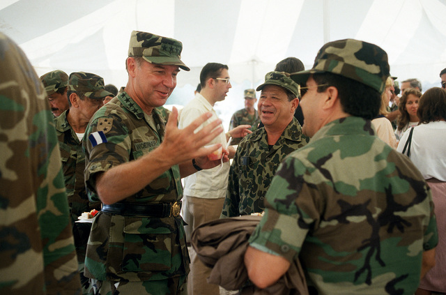 GEN. Frederick F. Woerner, commander-in-chief, U.S. Southern Command, converses with associates at the close of Task Force III, a civic action project in which the West Virginia Army National Guard built a road network and provided health and veterinary services to residents of the Puenta Grande area