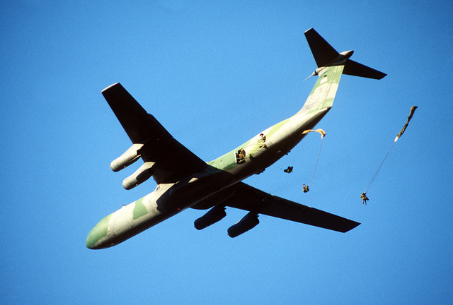 Members of the 82nd Airborne Division jump from a C-141B Starlifter aircraft. President Ronald Reagan mobilized U.S. exercise task force Dragon/Golden Pheasant, consisting of both the 82nd Airborne Division and the 7th Light Infantry Division, to help discourage Nicaraguan forces from entering Honduras