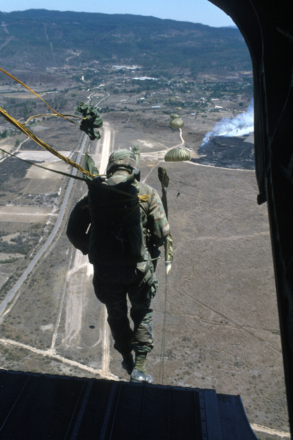 Members of the 82nd Airborne Division jump from a CH-47 Chinook helicopter in a joint US/Honduran jump during a mobilization of US Exercise Task Force DRAGON/GOLDEN PHEASANT.  The task force, consisting of both the 82nd Airborne Division and the 7th Light Infantry Division, was deployed by President Ronald Reagan to help discourage Nicaraguan forces from entering Honduras