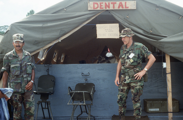 Soldiers of the West Virginia Army National Guard wait for patients at the field dental clinic set up for residents of the Puenta Grande area as part of Task Force III, a civic action program in which the guard is providing health and veterinary services and also building roads