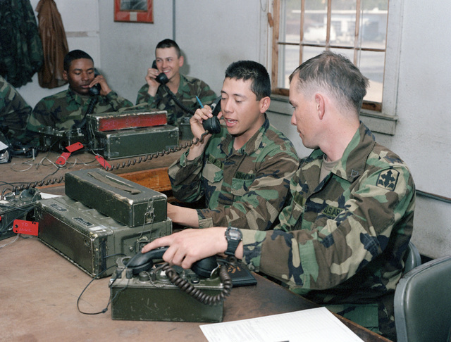 Privates (PVT) Waddy, Forsythe, Hernandez and Private First Class (PFC) Howard practice using SB-22A switchboard and TA312 field telephones during the Combat Signaler Course