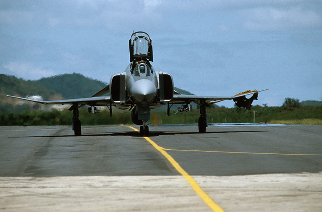 A front view of an F-4D Phantom II aircraft of the 42nd Tactical Fighter Group taxiing on the flight line during the reserve training Exercise PATRIOT PEARL. The exercise is a combined air operation of short duration designed to make maximum use of limited training