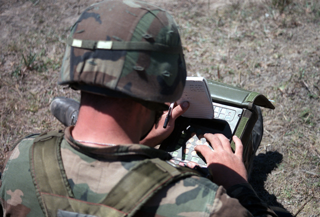 A soldier from the 82nd Airborne Division uses a fire control calculator to compute ballistic trajectories for a 60mm mortar fire mission during Operation Gold Pheasant