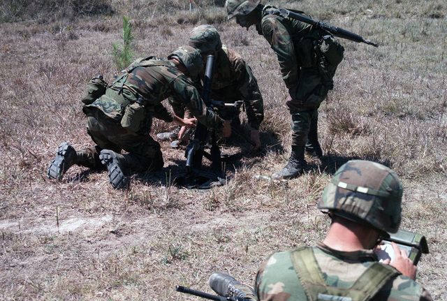 During Operation GOLDEN PHEASANT, an 82nd Airborne Division gun crew sets up an M224 60 mm lightweight company mortar while another soldier uses a fire control calculator to compute ballistic trajectories for a fire mission
