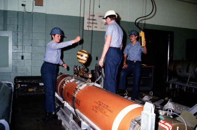 Students prepare to move a Mark 60 mine at the Fleet Mine Warfare Training Center (FMWTC).  The center, the only one of its kind in the Navy, trains new recruits as well as experienced Sailors in areas such as mine assembly, fire fighting, damage control, minehunter operations, computer board repair and leadership/management programs