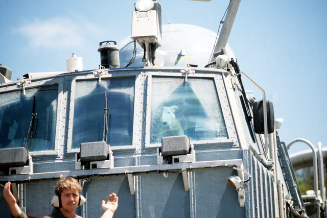 A crewman signals from in front of the bridge aboard the air cushion landing craft LCAC-8 during exercise Ocean Venture '88