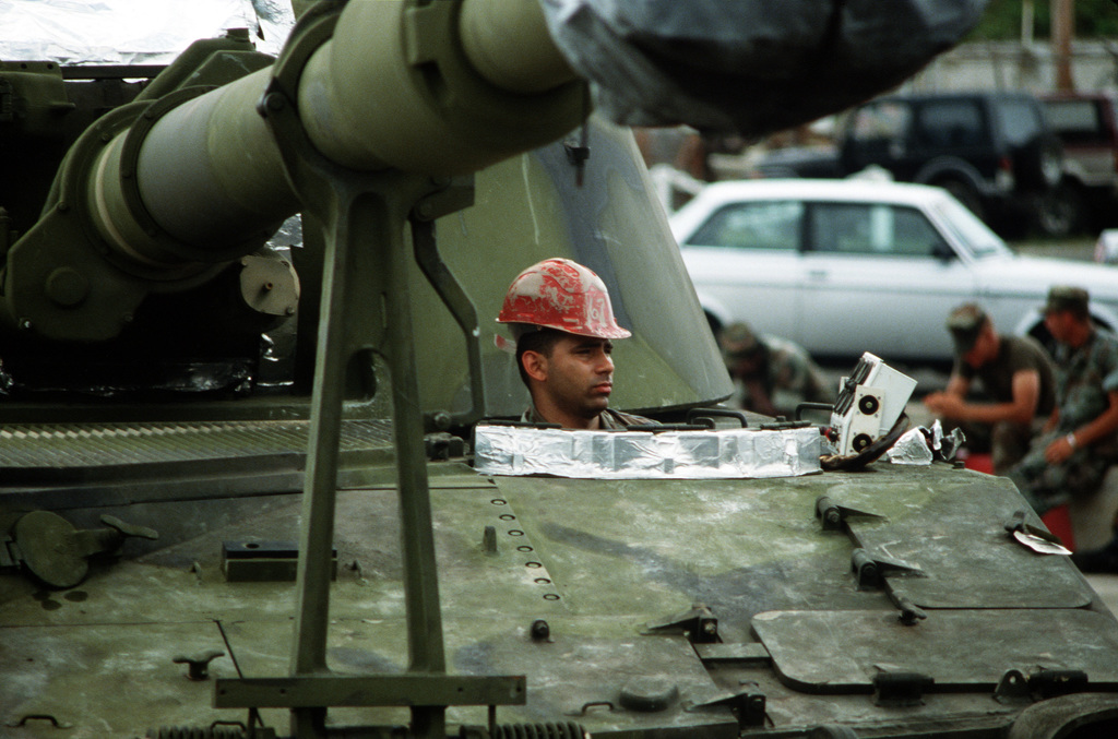 A Marine maneuvers an M-198 155mm self-propelled howitzer down a roadway during exercise Ocean Venture '88