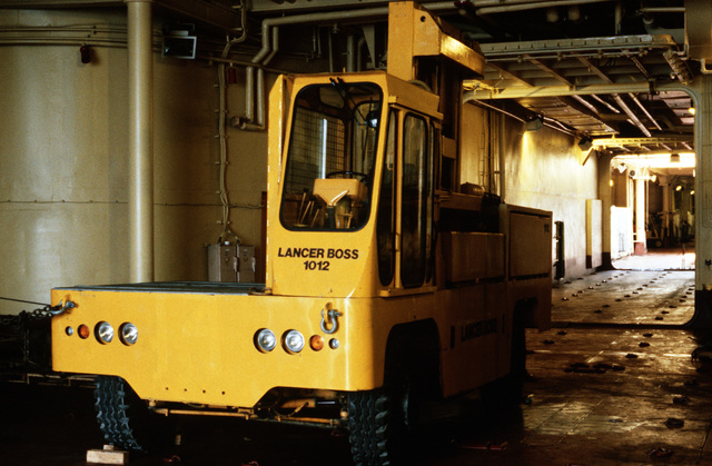 A materials handling vehicle is parked in the cargo hold of the maritime pre-positioning ship PFC EUGENE A. OBREGON (T-AK-3005) during exercise Ocean Venture '88