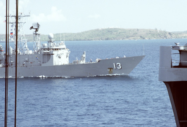The guided missile frigate USS SAMUEL ELIOT MORISON (FFG-13) passes another ship near the coast of Puerto Rico during exercise Ocean Venture '88. The MORISON is part of the Naval Reserve Force Atlantic Fleet