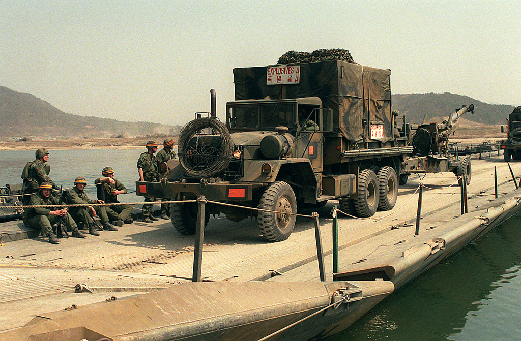 An M-813 5-ton cargo truck pulls an M-198 155mm howitzer across a ribbon bridge during the joint South Korean/U.S. Exercise Team Spirit '88