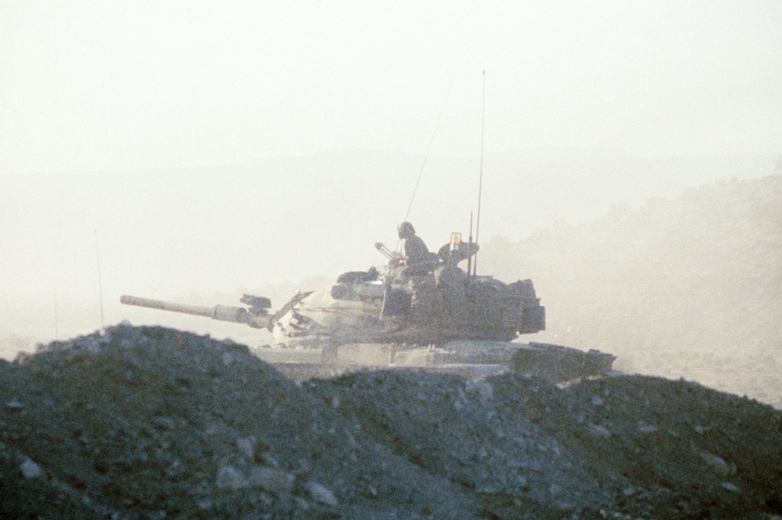 An M60 tank, modified to resemble a Soviet T72 tank, participates in an exercise at the National Training Center