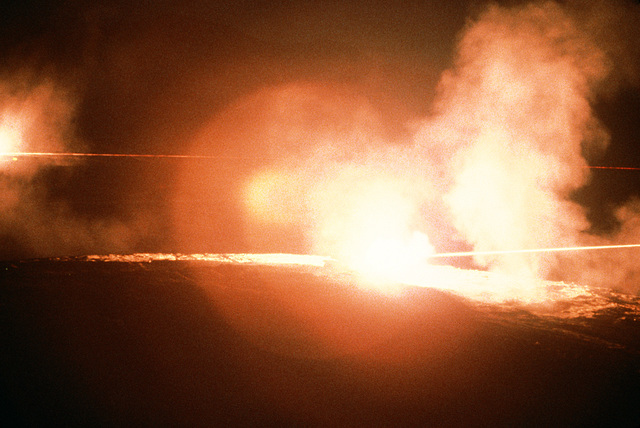 Tracers illuminate the night sky during a live fire demonstration at the National Training Center