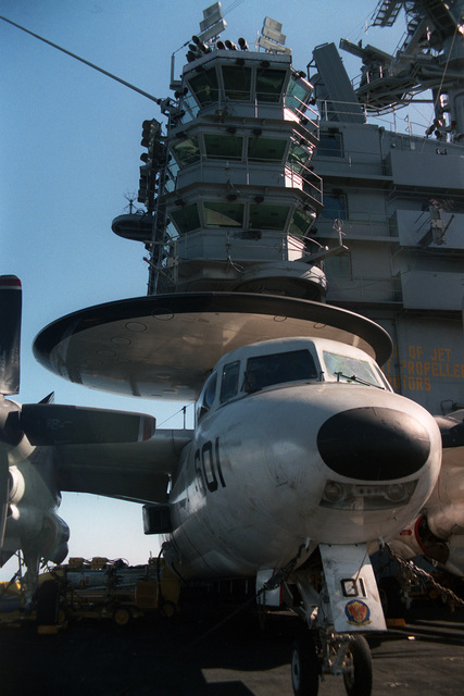 A front view of an E-2C Hawkeye aircraft from Carrier Airborne Early Warning Squadron 121 (VAW-121) tied down on the flight deck forward of the island on the US Navy (USN) Nuclear-powered Aircraft Carrier USS DWIGHT D. EISENHOWER (CVN 69)