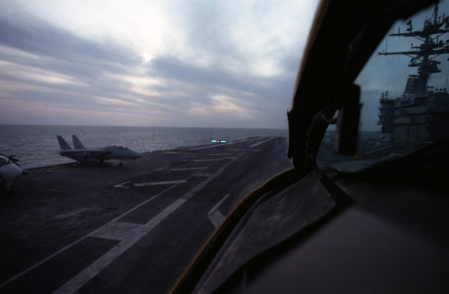 A view from the cockpit of an A-7E Corsair II aircraft as the aircraft approaches for a landing aboard the nuclear-powered aircraft carrier USS DWIGHT D. EISENHOWER (CVN 69).  Note:  Fourth view in a series of four