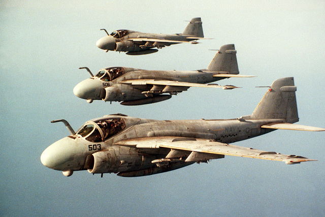 An air-to-air left side view of three Attack Squadron 34 (VA-34) A-6E Intruder aircraft flying in formation