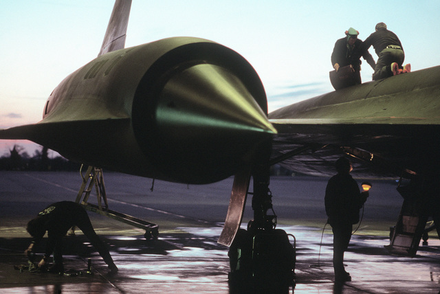 Civilian technicians prepare an SR-71 Blackbird aircraft from the 9th Strategic Reconnaissance Wing, RAF Mildenhall, for another mission in support of the National Command Authority