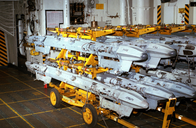 Ordnance multiple ejector racks (MER) are stored on Aero 83A transport adapters mounted on Aero 21A weapons skids aboard the nuclear-powered aircraft carrier USS DWIGHT D. EISENHOWER (CVN 69)