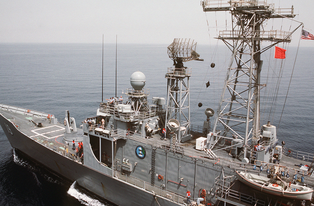 The guided missile frigate USS JOHN A. MOORE (FFG 19) participates in an underway replenishment
