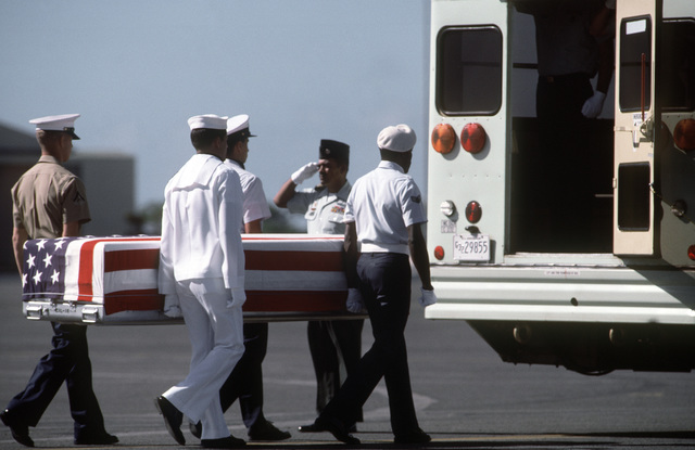 An all service pall bearer squad loads the remains of one of 27 missing in action service members onto a bus.  The service members were returned in the largest turnover of MIAs since meetings began with North Vietnam in 1981
