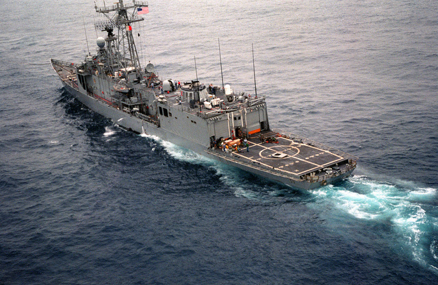 A starboard quarter view of the guided missile frigate USS SAMUEL B. ROBERTS being towed after the ship struck a mine on April 14, 1988