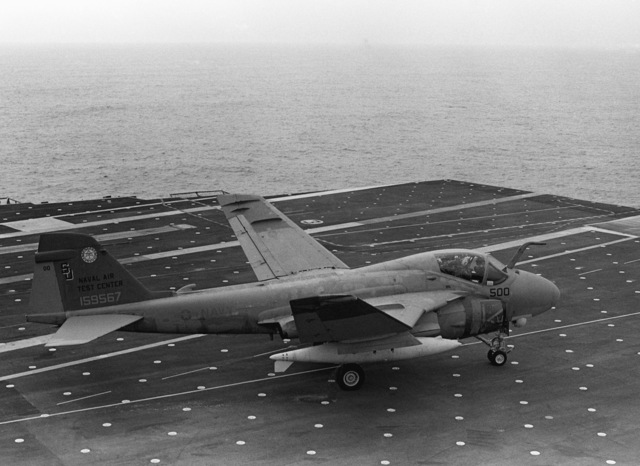 An A-6E Intruder aircraft of the Naval Air Test Center is readied for takeoff from the flight deck of the aircraft carrier USS INDEPENDENCE (CV 62)