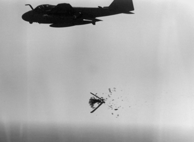 A CBU-59 cluster bomb splits open to release its bomblets after being dropped from an A-6E Intruder aircraft during an attack on an Iranian target. The attack is in retaliation for the mining of the guided missile frigate USS SAMUEL B. ROBERTS (FFG-58)