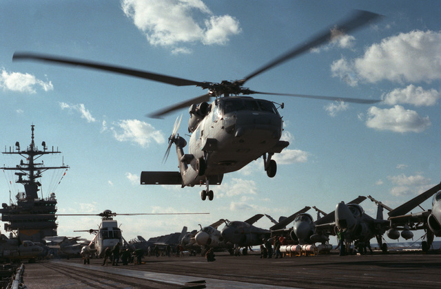 An SH-60F Sea Hawk helicopter from Air Test and Evaluation Squadron 1 (VX-1) takes off from the flight deck of the nuclear-powered aircraft carrier USS DWIGHT D. EISENHOWER (CVN 69)