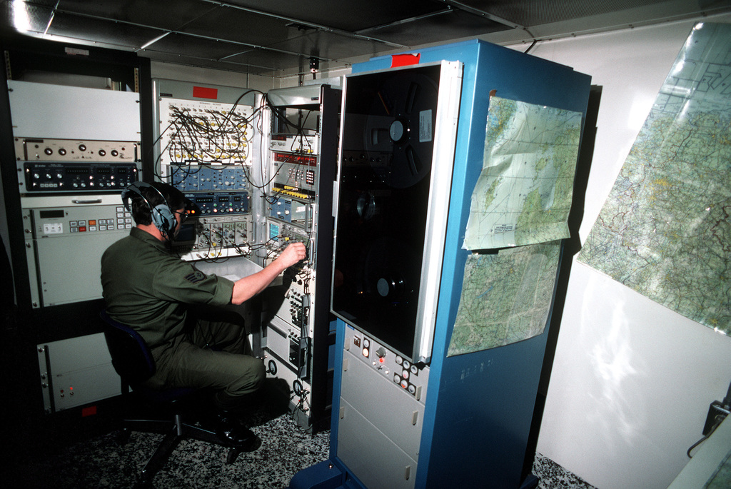 SSGT Rex C. Brunelli, an electronic intelligence (ELINT) operations specialist with Detachment 4, 9th Strategic Reconnaissance Wing, processes data in the detachment's ELINT analysis van