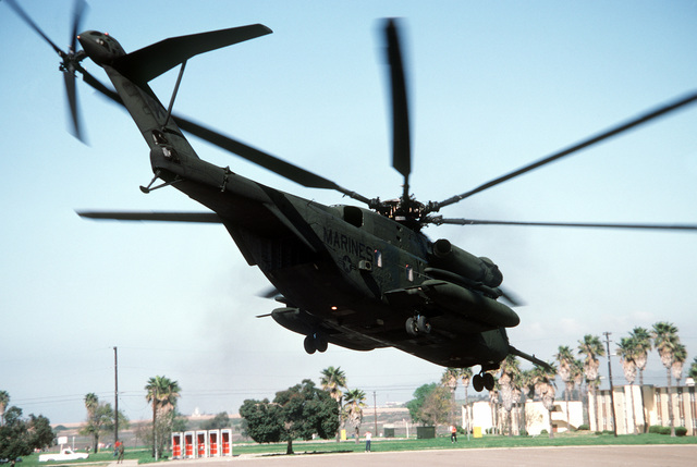 A CH-53E Super Stallion helicopter from Marine Heavy Helicopter Squadron 466 (HMH-466)lifts off from a landing zone behind a row of barracks at the combat center during Exercise Gallant Eagle '88