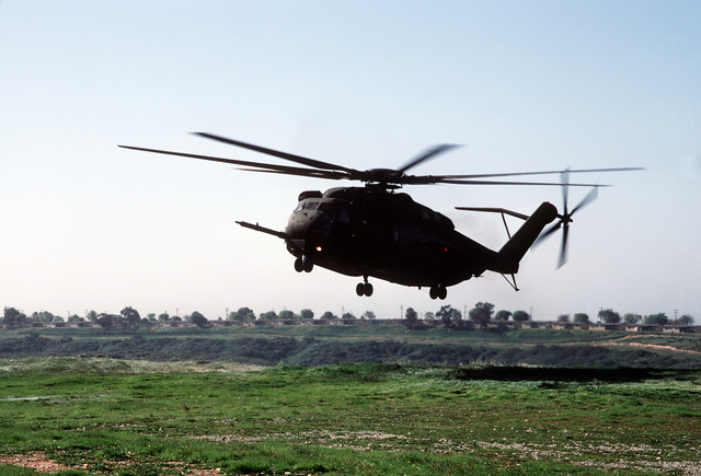 A CH-53E Super Stallion helicopter from Marine Heavy Helicopter Squadron 466 (HMH-466) comes in to land in a field at the combat center during Exercise Gallant Eagle '88
