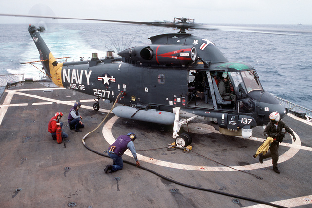 A Light Helicopter Anti-submarine Squadron 32 (HSL-32) SH-2F Seasprite helicopter is refueled on the helicopter deck of the guided missile cruiser USS WAINWRIGHT (CG-28)