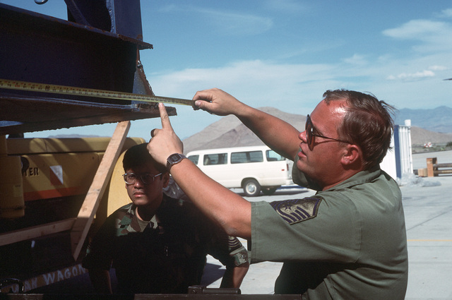 SENIOR MASTER Sergeant (SMSGT) Bud Liston measures a Cardwell-500 drilling rig part in order to judge clearance prior to loading part onto a 60th Marine Air Wing C-5B Galaxy aircraft.  The rig will be flown to Semipalatinsk, USSR, where it will be used to