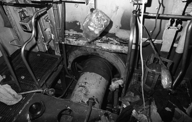 A view of damage in the main engine room of the guided missile frigate USS SAMUEL B. ROBERTS (FFG-58) sustained when the ship struck a mine while on patrol in the Persian Gulf on April 14, 1988. The propeller shaft is in the center. The ship is in dry dock undergoing temporary repairs