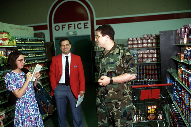 Darcy Trick interviews SSGT Mark S. Schore, 1837th Electronics Installation Squadron, as Robert M. Sarka, commissary officer, stands by at the Yokota Commissary. Trick is interviewing base personnel as part of a week-long survey conducted by USA Today. The newspaper will later publish a series of articles based on this survey and a USA Today-sponsored town meeting which will focus on the lives of military personnel stationed overseas