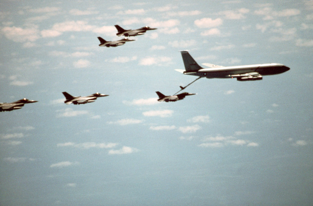 A 940th Aerial Refueling Group KC-135E Stratotanker aircraft refuels F-16 Fighting Falcon aircraft.  Stratotankers from the unit are deployed to RAF Mildenhall to provide aerial refueling support to aircraft of the US Air Forces Europe