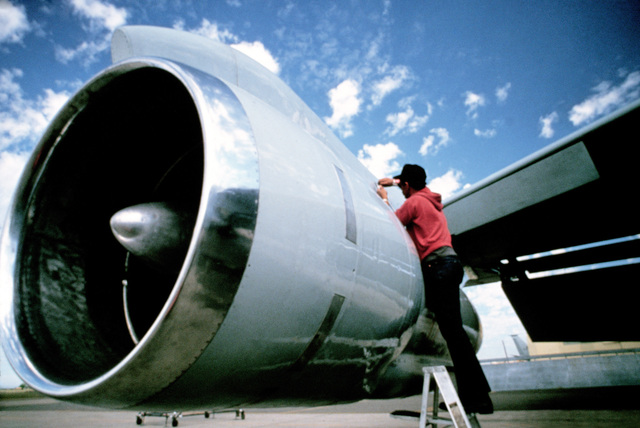 A techinician inspects the TF-33 engine of a 940th Air Refueling Group KC-135E Stratotanker aircraft.  Stratotankers from the unit are being deployed to RAF Mildenhall, England to provide aerial refueling support to aircraft of the US Air Forces Europe