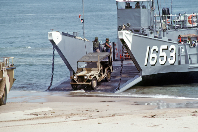 An M151 light vehicle comes ashore from a utility landing craft LCU 1653 during an amphibious demonstration for the 14th Annual Inter-American Naval Conference
