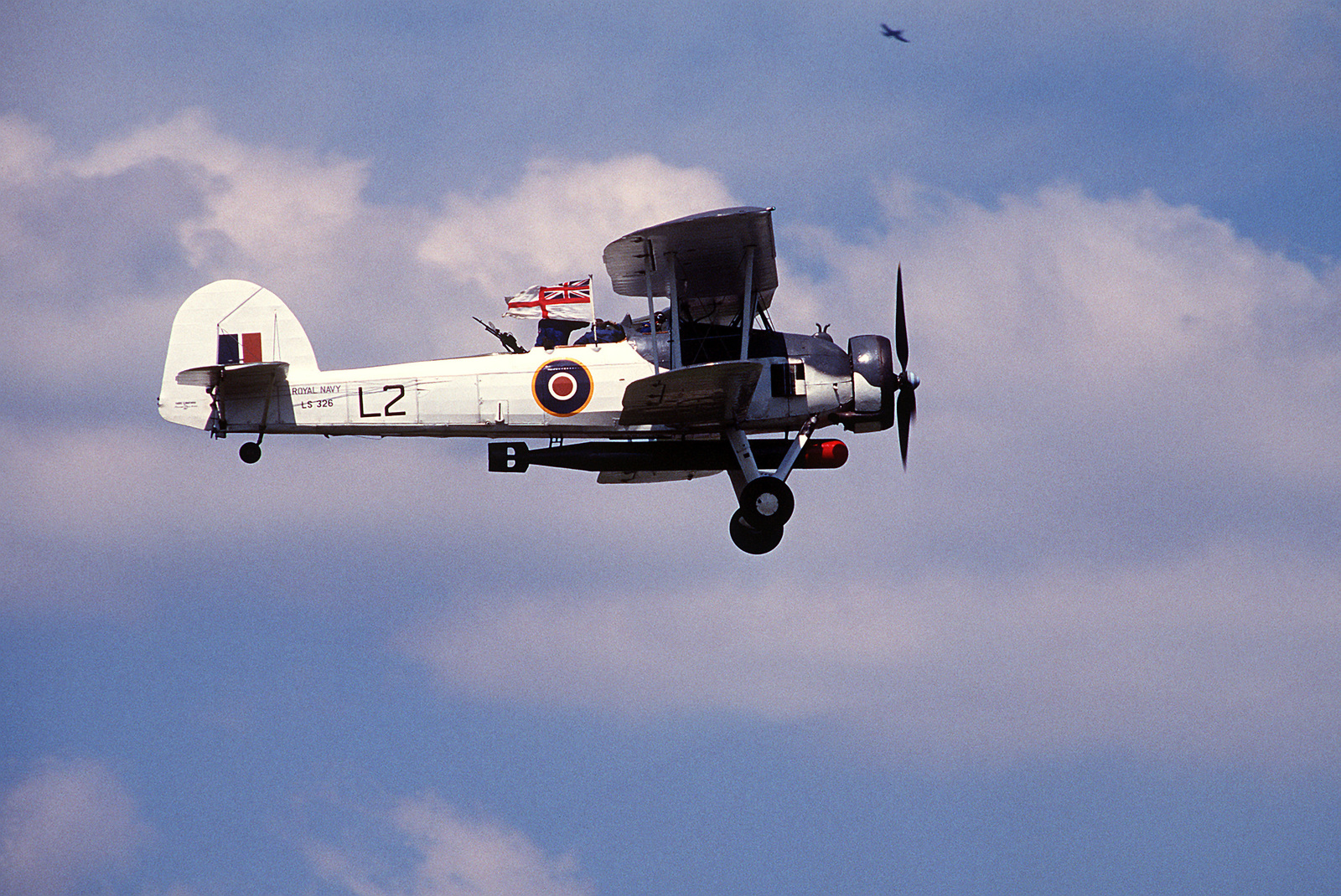 A right side view of a World War II British TBM-3 Avenger torpedo bomber aircraft in-flight during Air Fete '88, a NATO aircraft display hosted by the 513th Airborne Command and Control Wing