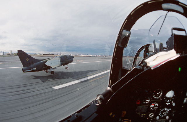 A view from the rear seat of an A-7K Corsair II aircraft of the 150th Tactical Fighter Group as it takes off in tandem with an A-7D during Exercise AMALGAM WARRIOR 88.  AMALGAM WARRIOR 88, the largest air defense exercise of the year designed to afford un