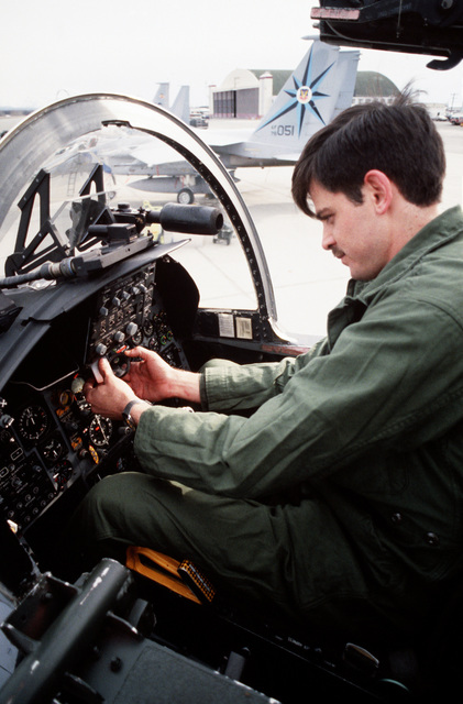 Sergeant (SGT) Randy Cook from the 318th Fighter Interceptor Squadron checks the controls of an F-15 Eagle aircraft after a sortie.  The squadron is participating in AMALGAM WARRIOR 88, the largest air defense exercise of the year designed to afford units