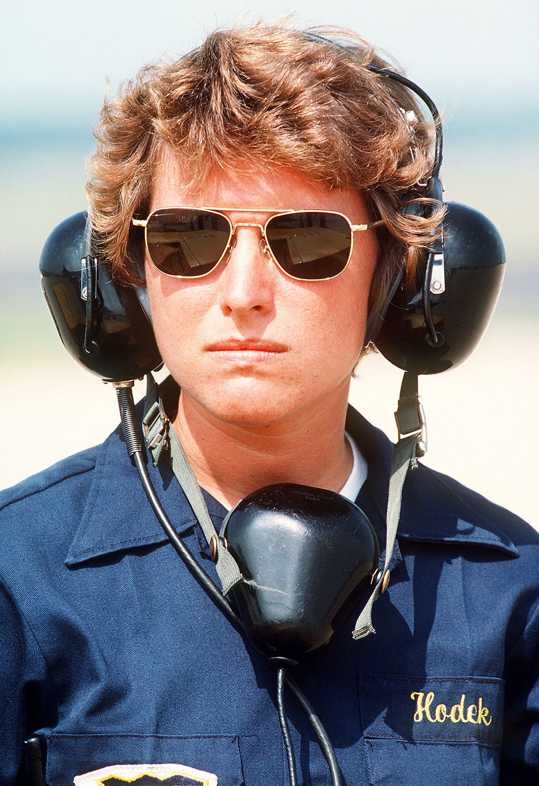 A female ground crew member provides ground support for the Blue Angels, the Navy's flight demonstration team